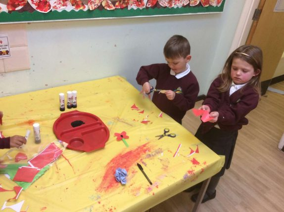 We made our own poppies for Remberance Day. We worked really hard to hold the scissors correctly and turn the paper as we cut.